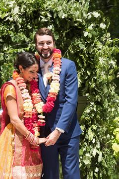 Indian bride  and groom with garlands capture.