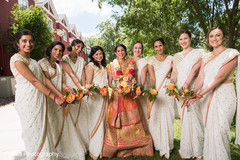 Lovely Indian bride and bridesmaids outdoor portrait.