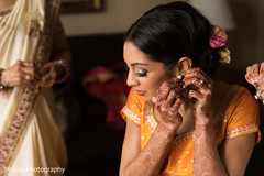 Indian bride getting her earrings on.