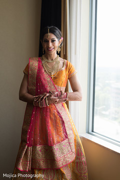 Beautiful Indian bride showing henna art.