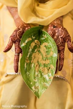 Turmeric paste on a leaf capture.