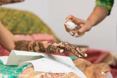 Indian bride getting her mehndi art done.