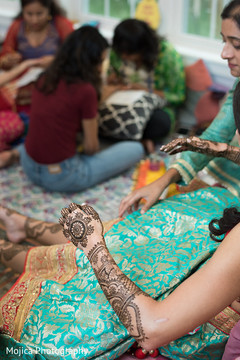 Maharani waiting for henna paint to dry capture.