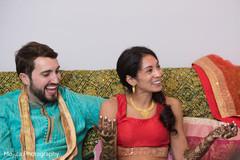 Joyful India couple at their pre-wedding mehndi celebration.
