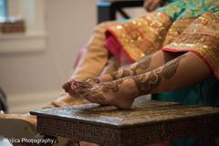 Intricate mehndi design for maharani's feet.