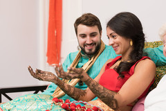 Indian bride and groom  during the mehndy celebration.