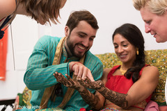 Lovely capture of bride and groom at mehndi party.