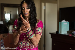Indian bride getting her reception bangles on.