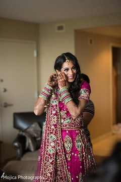 Maharani putting her earrings on for wedding reception.