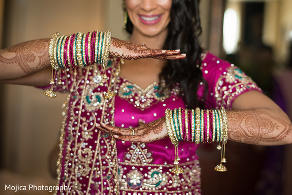Indian bride showing her reception bangles.