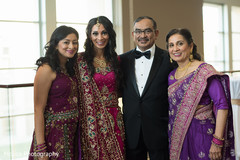Adorable Indian bride posing with family.