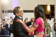 Father and daughter Indian wedding dance performance.