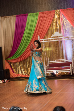 Indian bride dancing at her sangeet party.