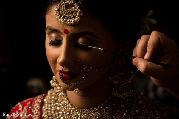 Lovely bride getting her makeup done
