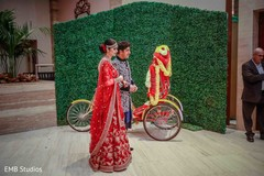 Wonderful Indian bride and groom walking in to sangeet.