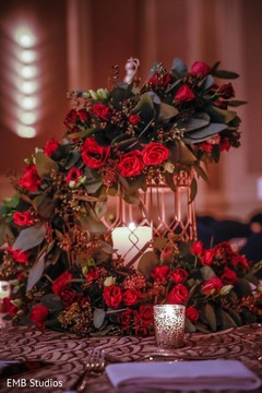 Marvelous Idea for sangeet table decoration with cage and Crown of flowers.
