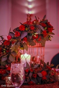 Romantic Indian sangeet table cage with flowers decor.