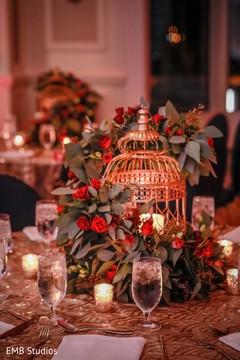Radiant Indian sangeet table centerpiece decor.