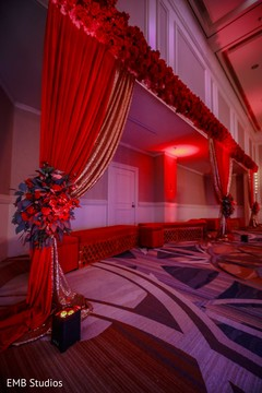 Lights, flowers and draping decoration for sangeet.