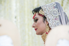 Stunning Indian bride with her wedding ceremony Ghoonghat.