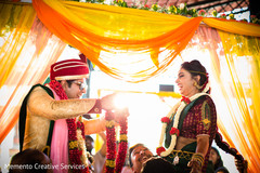 Traditional indian bride and groom's jai mala ceremony