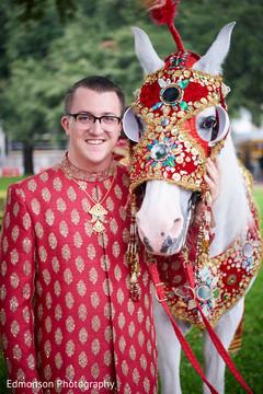 Elegant Indian groom and baraat white horse.
