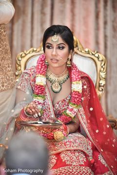 Tender Indian bride at her wedding ceremony.