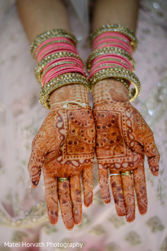 Indian bride showing marvelous mehndi art