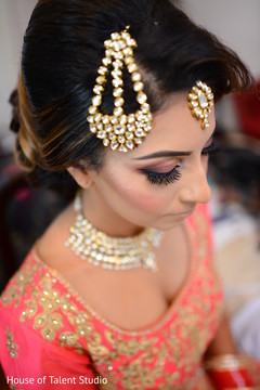 Indian bride's Ganesha hair accessory.