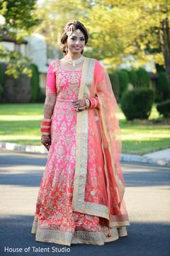 Ravishing Indian bride looking at camera capture.
