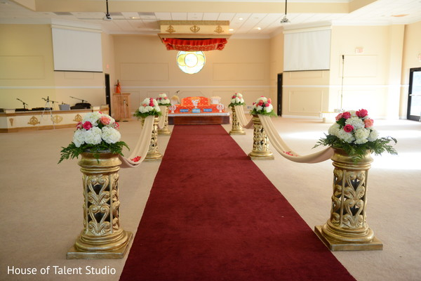 Indian wedding aisle flowers and pillar decorations.