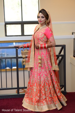 Indian bride posing with their ceremony Anarkali.