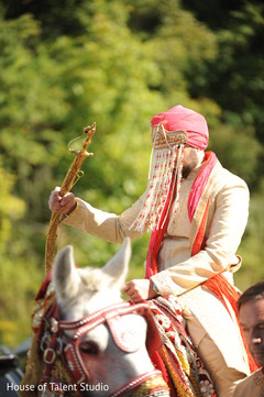 Charming Indian groom on his baraat celebration.
