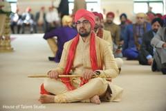 Indian groom with his sword capture.