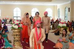 Ravishing indian bride making her entrance to wedding ceremony.