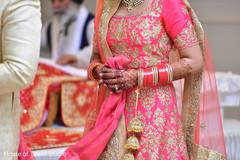 Indian bride following groom during the Saptapadi.