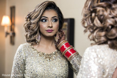 Indian bride with her wedding reception makeup done.