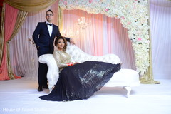 Gorgeous Indian bride and groom at their wedding reception stage.