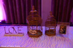 Indian wedding reception cage decorations.