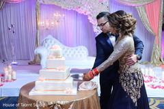 Marvelous Indian wedding cake cutting moment.
