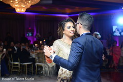 Gorgeous Indian bride and groom at their wedding reception dance.