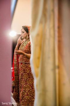 Marvelous Indian bride on her ceremony attire.