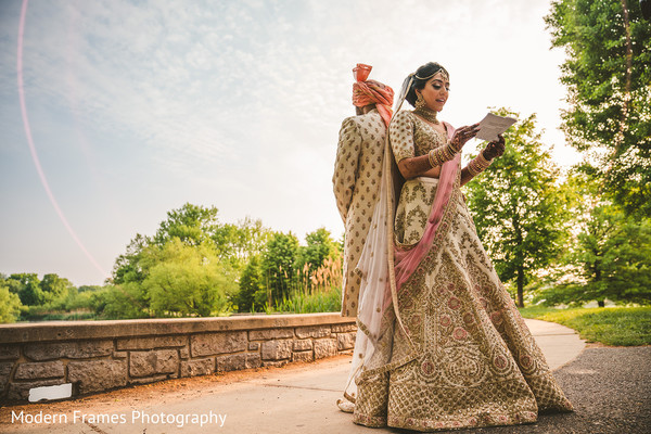 Indian bride reading card from groom