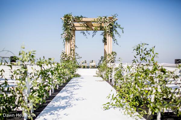 Stunning Indian wedding  aisle flower decorations.