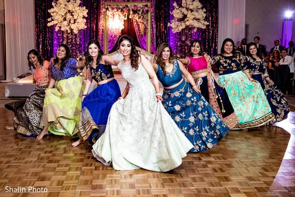 Upbeat Indian wedding dance performance scene.