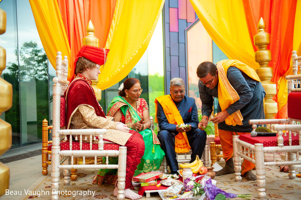 Indian groom on a pre-ceremony ritual with parents.