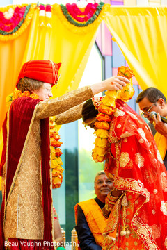 Indian bride and groom at their varmala ceremony garland exchange ritual.