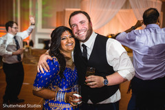 Indian couple enjoying their reception