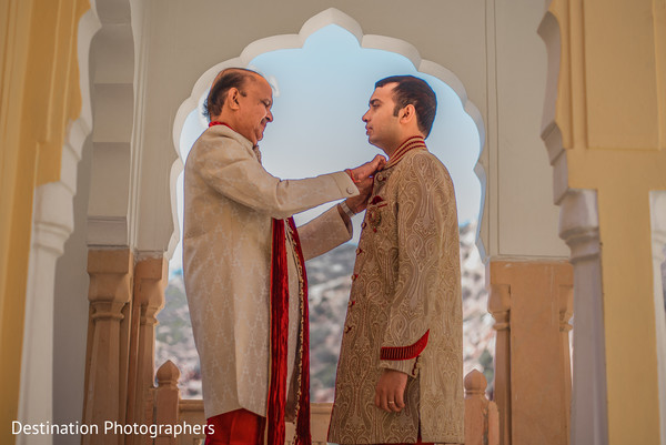 Indian groom getting ready scene