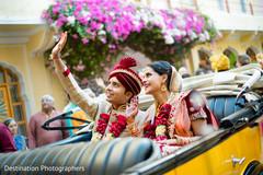 Indian lovebirds inside wedding car